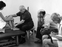 Dr. Feldenkrais working with a child