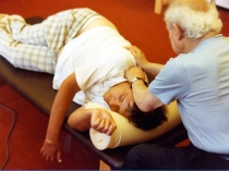 Dr. Moshé Feldenkrais working with a client