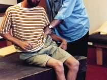 Moshé Feldenkrais works with a disabled man