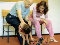 Moshé Feldenkrais working with child and Anat Baniel
