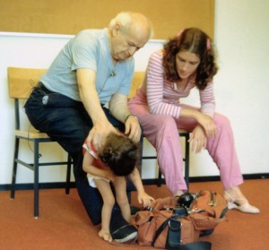 Moshe Feldenkrais working with child and Anat Baniel